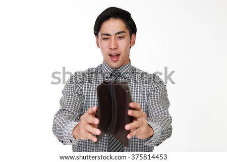 Smiling Asian businessman with a wallet  - stock photo
