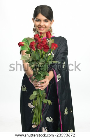 Smiling Asian girl with red roses - stock photo