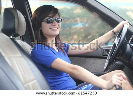 smiling asian lady driver - stock photo