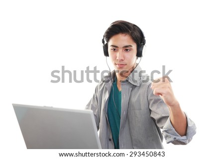 Smiling Asian man with a laptop - stock photo