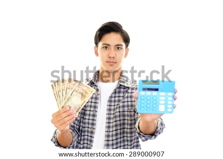 Smiling Asian man with money - stock photo