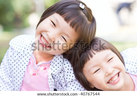 smiling asian twin girls - stock photo