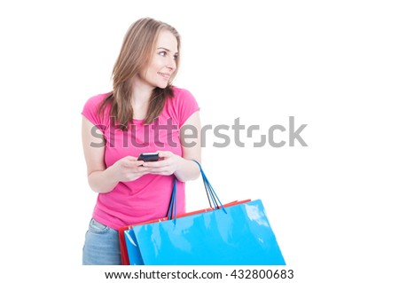 Smiling attractive girl working on smartphone and relaxing on shopping isolated on white with advertising area - stock photo