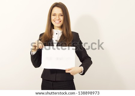 Smiling attractive woman holding blank paper isolated - stock photo