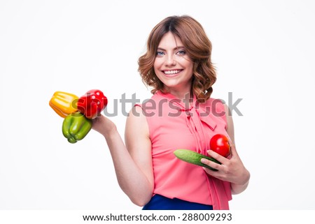 Smiling attractive woman holding vegetables isolated on a white background. Looking at camera - stock photo