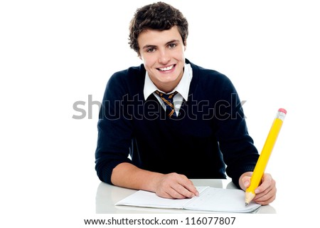 Smiling attractive youngster kid studying isolated over white background - stock photo