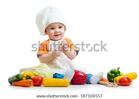 smiling baby cook with vegetables - stock photo