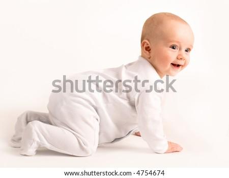 Smiling baby crawls isolated on white - stock photo