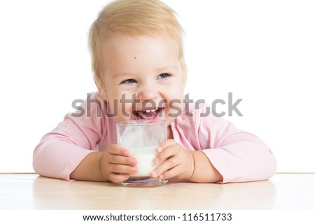 smiling baby drinking yogurt or kefir over white - stock photo