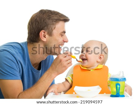 smiling baby eating food - stock photo