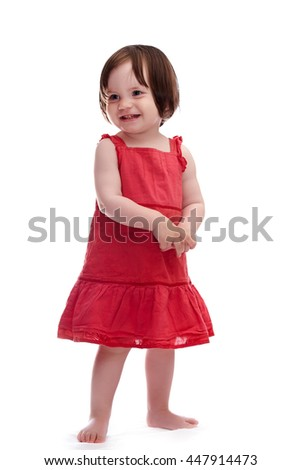 Smiling baby girl in red dress isolated on white background - stock photo