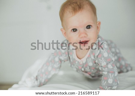 smiling baby girl in the morning - stock photo