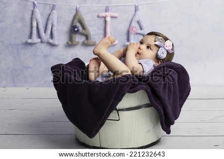 Smiling Baby Girl in tub - stock photo