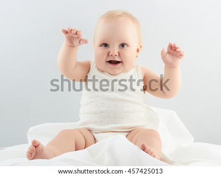 smiling baby girl. little funny child.newborn - stock photo