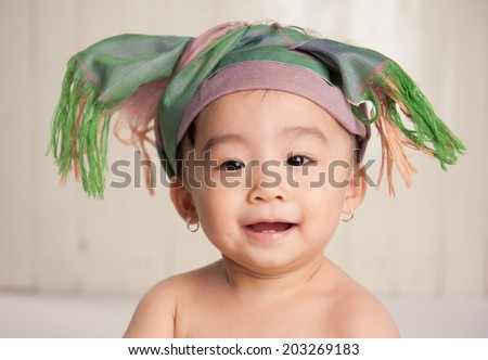 smiling baby hat scarf look at camera - stock photo