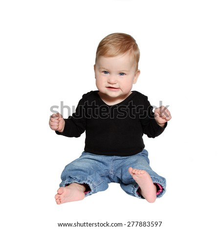 smiling baby sits on white background - stock photo