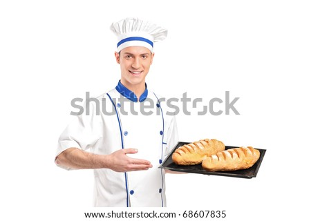 Smiling baker showing freshly baked breads isolated on white background - stock photo