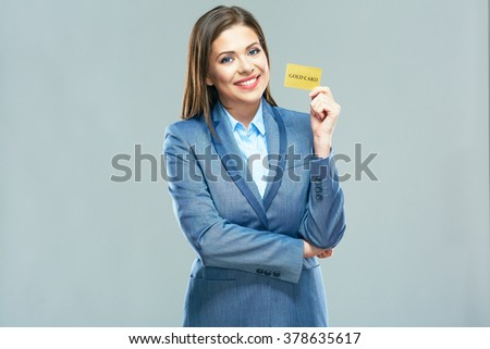 Smiling bank employee woman suit dressed show plastic credit card. Smiling model with long hair isolated studio portrait. - stock photo
