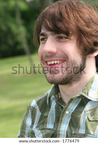 Smiling bearded man. - stock photo