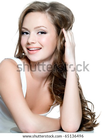 Smiling beautiful face of teenager girl with clean skin - isolated on white - stock photo