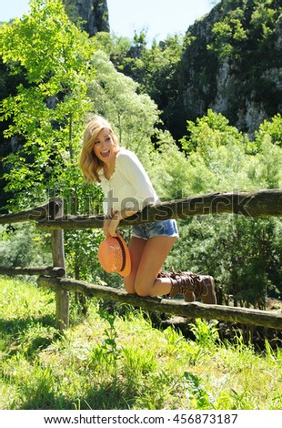 Smiling beautiful girl have fun at the countryside - stock photo