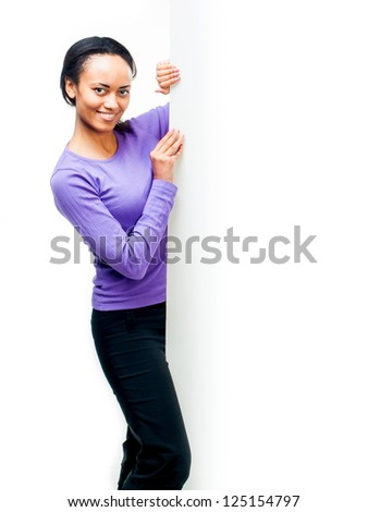 Smiling beautiful girl with empty white board - stock photo