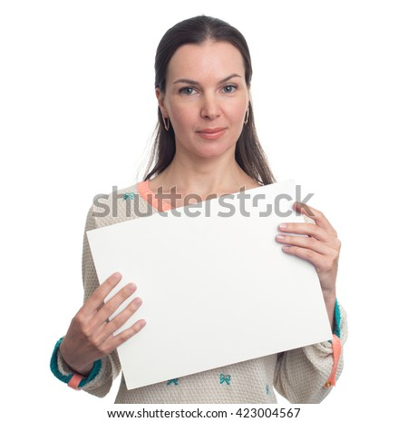 Smiling beautiful woman holding blank white banner. Isolated - stock photo