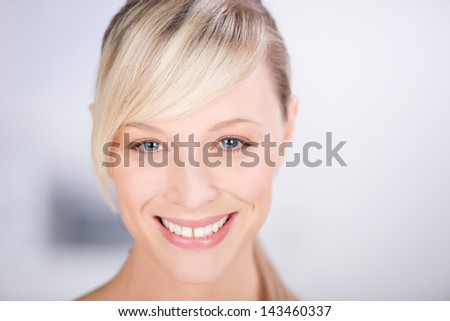 Smiling beautiful woman over the white background - stock photo