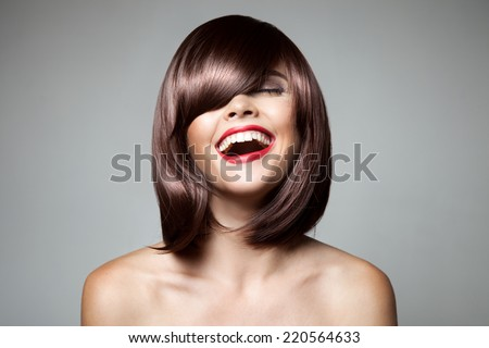 Smiling Beautiful Woman With Brown Short Hair. Haircut. Hairstyle. Fringe. Professional Makeup. - stock photo