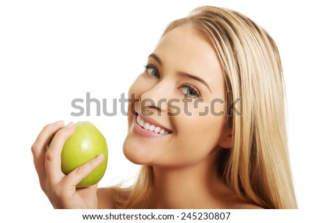 Smiling beauty holding green apple  - stock photo
