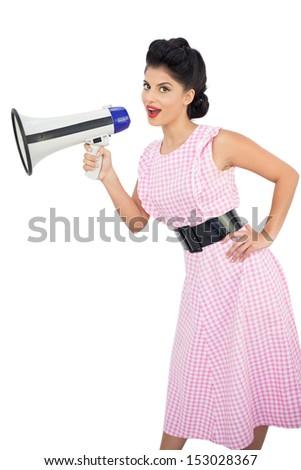 Smiling black hair model holding a megaphone on white background - stock photo
