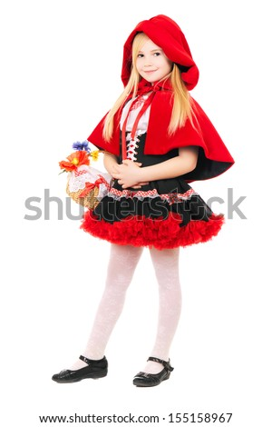 Smiling blond girl posing in a dress of little red riding hood. Isolated on white  - stock photo