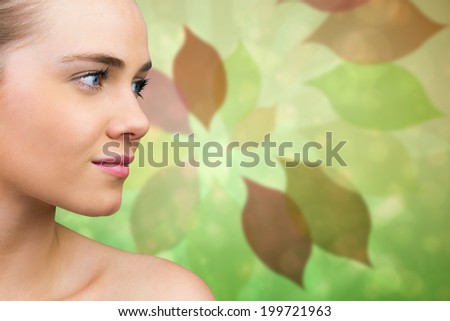 Smiling blonde natural beauty against leaf pattern in green and brown - stock photo