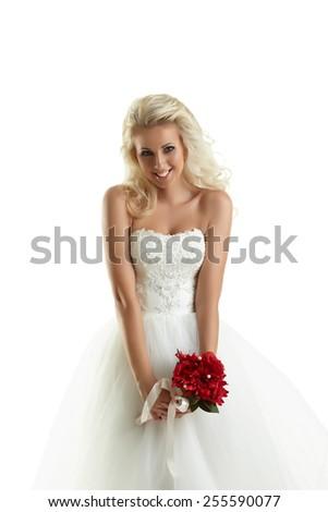 Smiling blonde posing as happy bride - stock photo