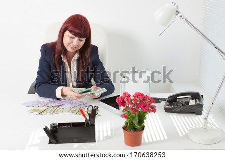 smiling book-keeper counts bank notes - stock photo