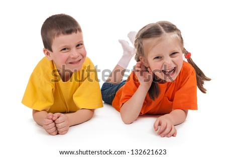 smiling boy and girl on white - stock photo