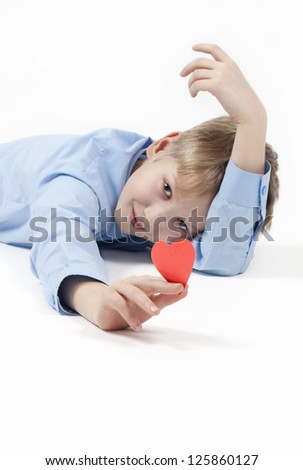 Smiling boy and red heart. - stock photo