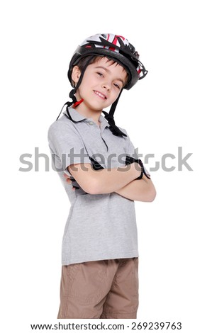 Smiling boy cyclist with crossed hands in a white studio - stock photo