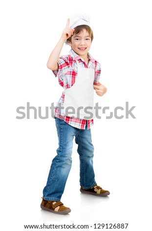 smiling boy dressed as a cook shows up isolated on a white background - stock photo