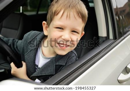smiling boy driving horizontal - stock photo