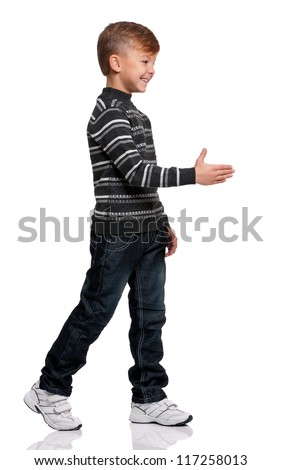 Smiling boy greets with his hand isolated on white background - stock photo