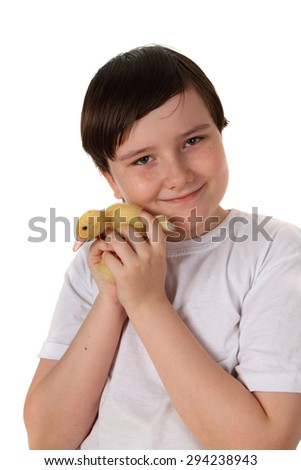 Smiling boy holding a duckling on a white background - stock photo
