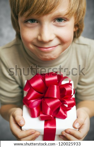 Smiling Boy holding present box isolated on white - stock photo