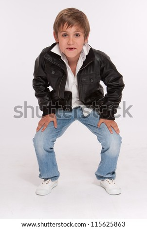 Smiling boy in a crouching position - stock photo