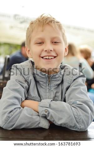 smiling boy looking at the camera - stock photo