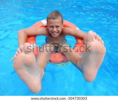 smiling boy on lifebuoys - stock photo