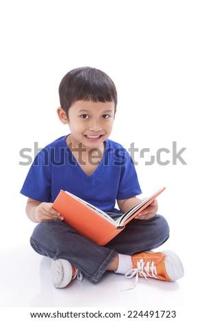 Smiling boy reading book - stock photo