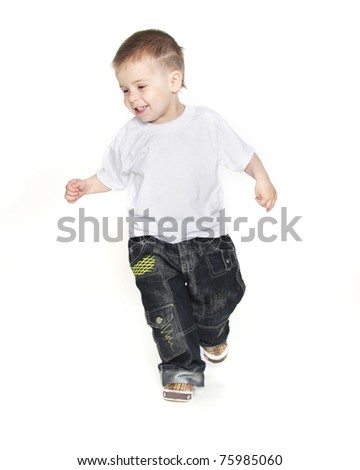 smiling boy running over white - stock photo