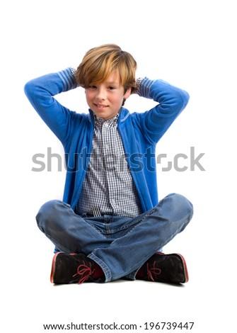 Smiling boy sitting - stock photo