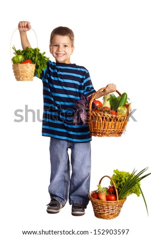 Smiling boy standing with baskets of fresh vegetables, isolated on white - stock photo